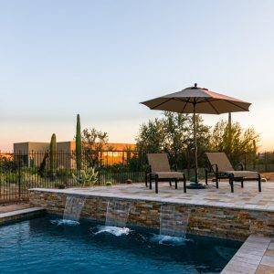 Poolside seating with water features on the ledge