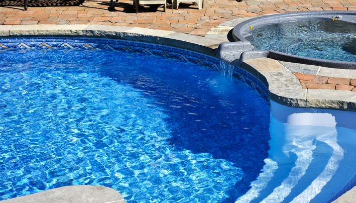 A hot tub flowing into a pool, an example of spillover spas