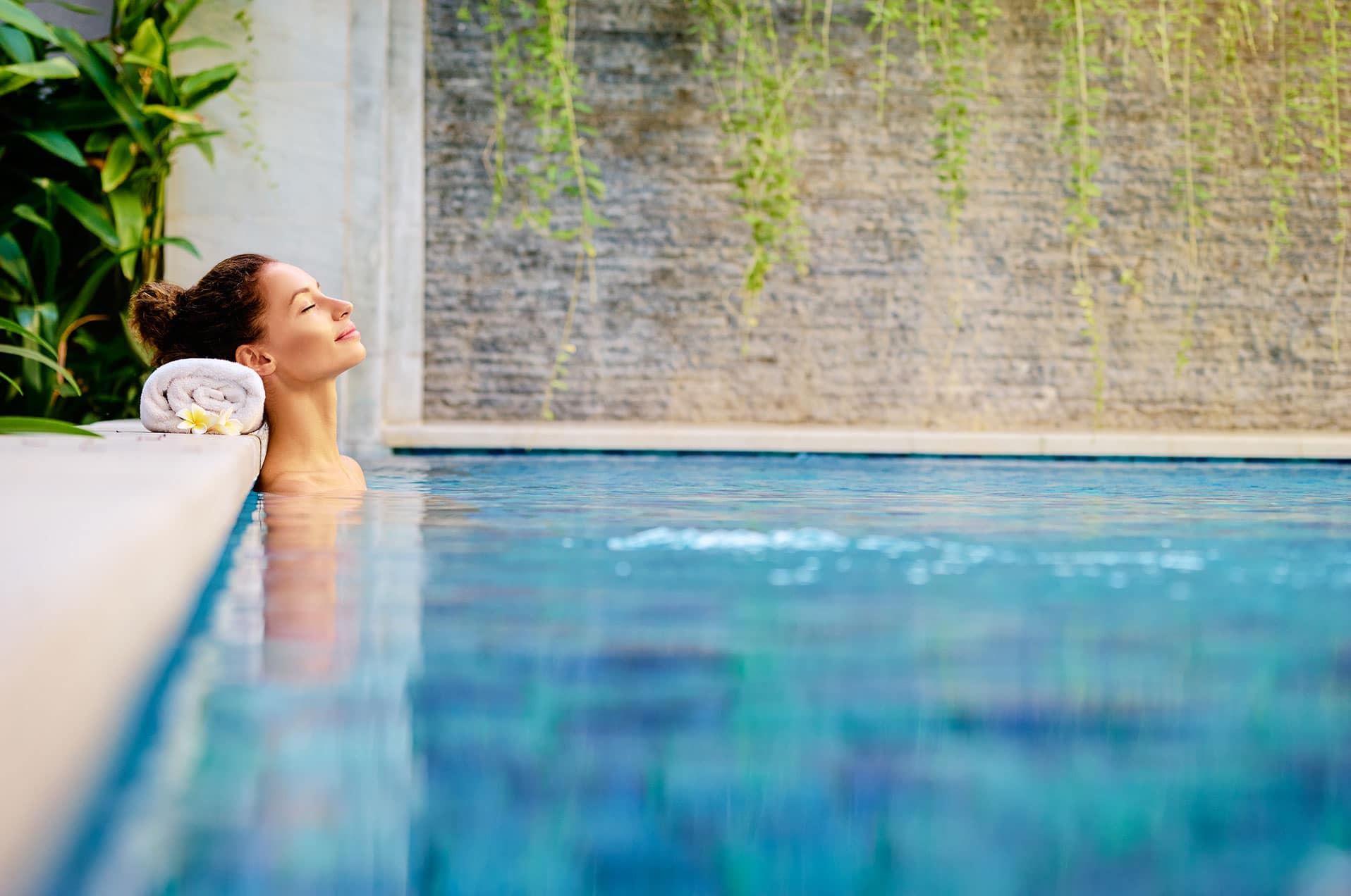 A woman relaxing in an outdoor pool