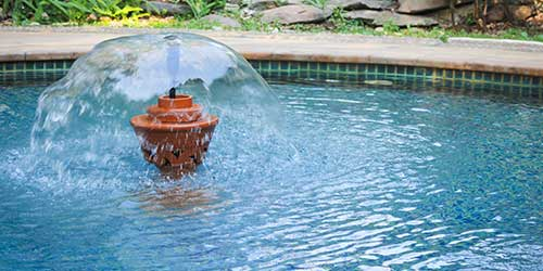 A swimming pool fountain