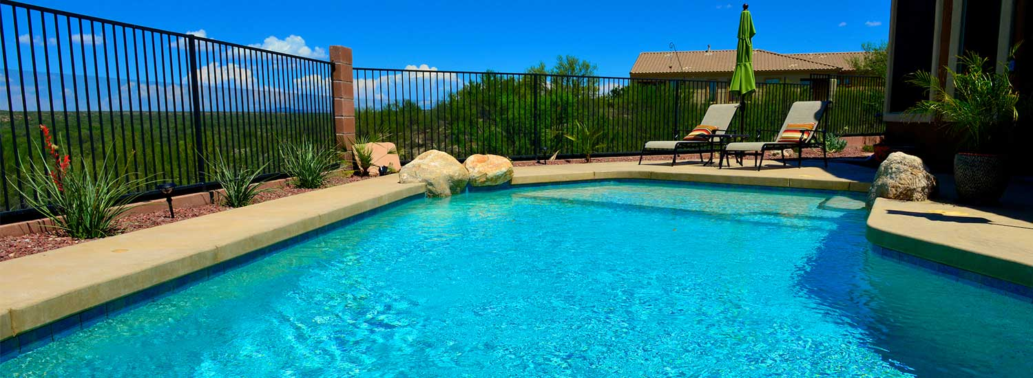 A traditional style swimming pool in an Arizona backyard