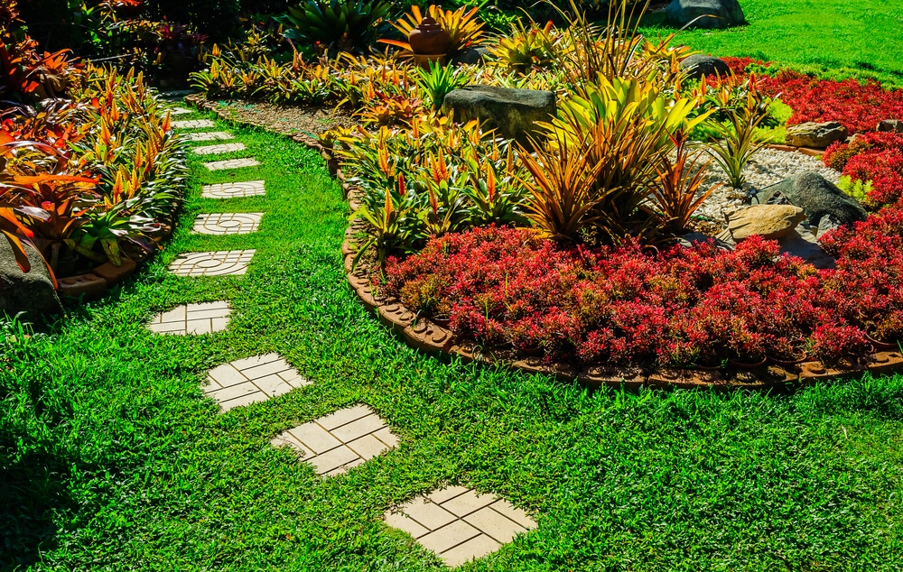 A garden path through grass and tropical plants. Turn your desert landscape into a lush oasis like this.