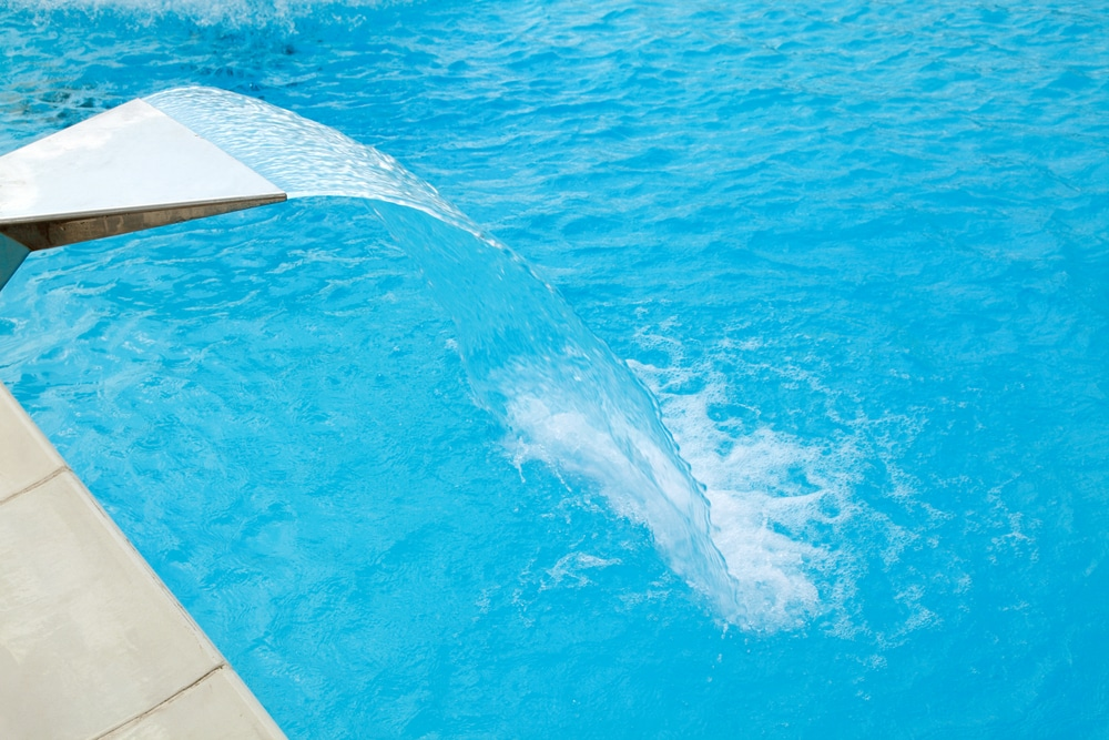 How Pool Designs Benefit from Rain Curtains