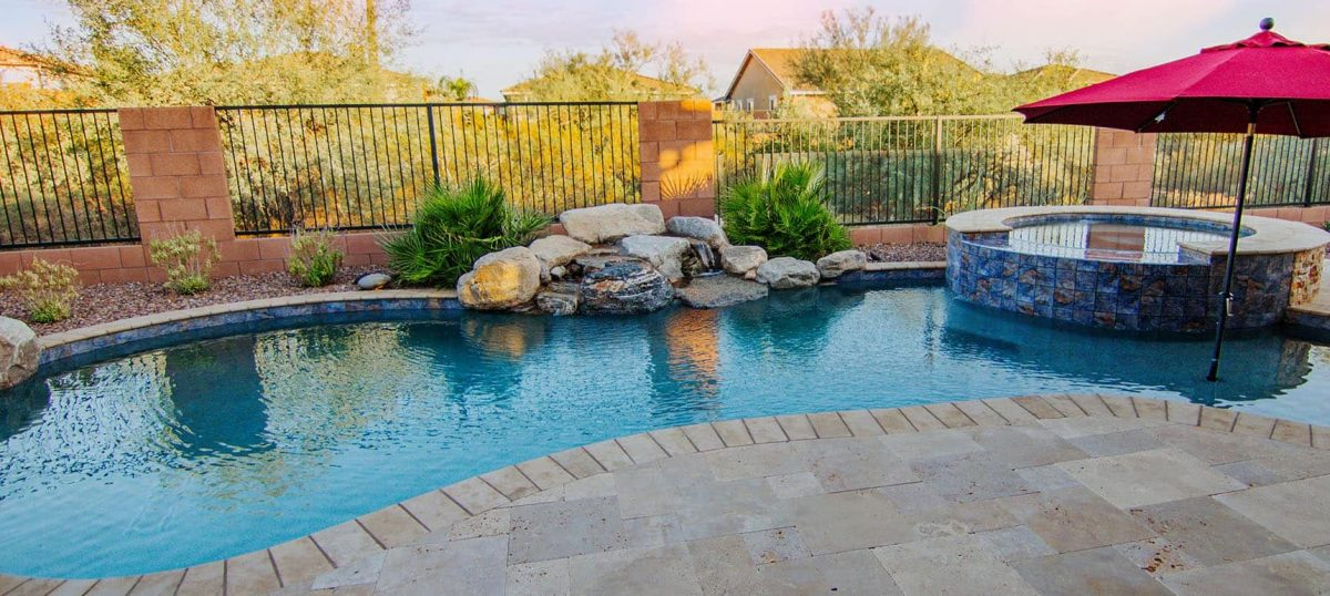 A custom inground pool and spillover spa built by our Master Pool builders