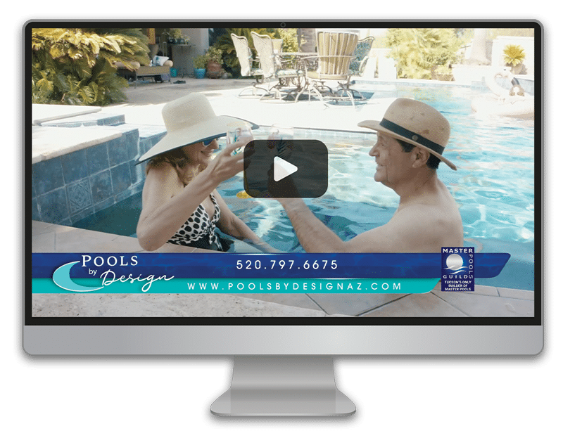 A mac screen showing a video paused on screen with the still shot of a couple in their pool enjoying a drink together