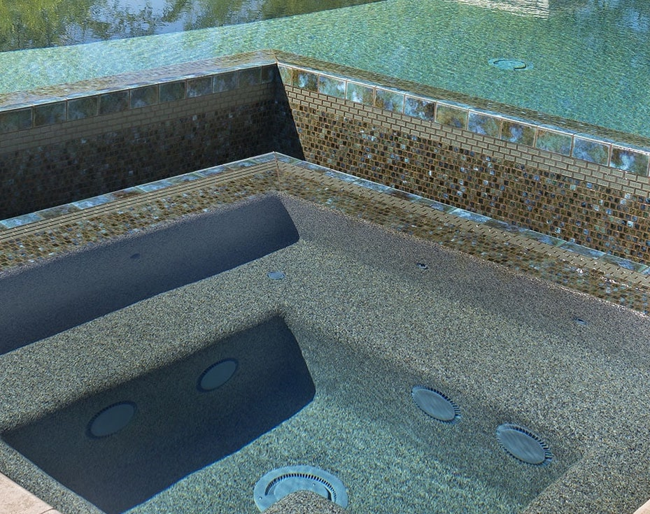 A spa with a beautiful Pebble Tec pool finish