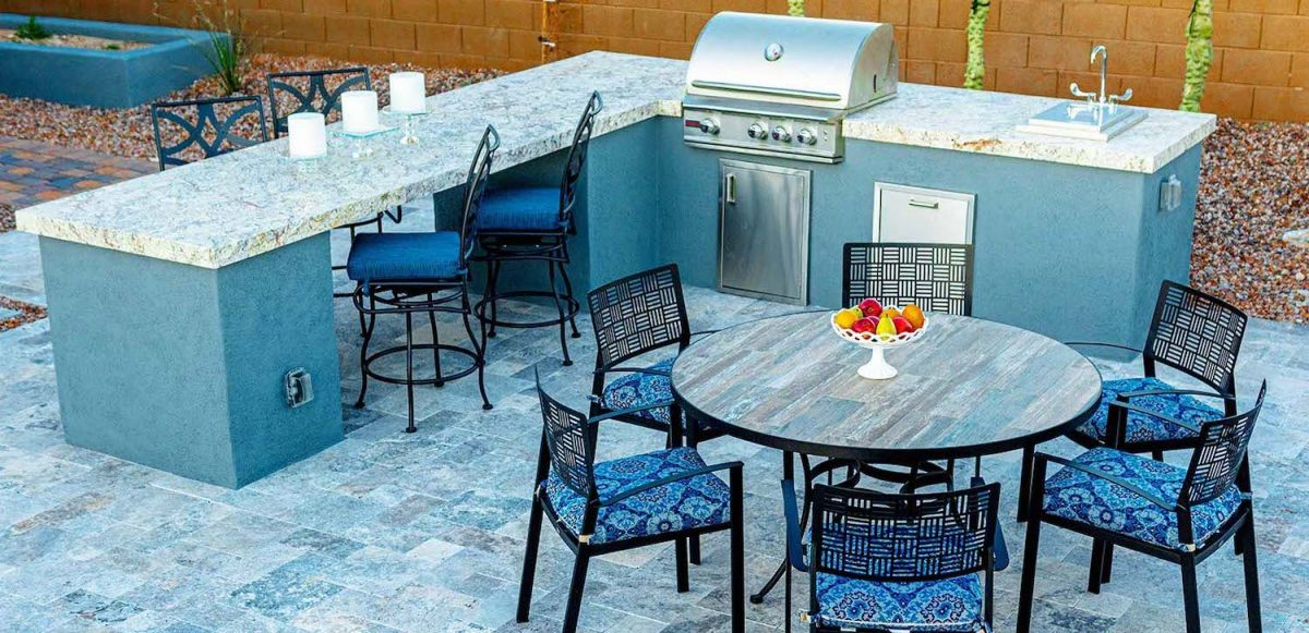 A BBQ island and dining area, some of the many outdoor kitchen ideas we can create