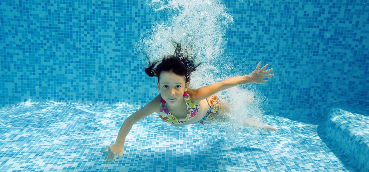 A kid jumping into a pool, representing pool depth