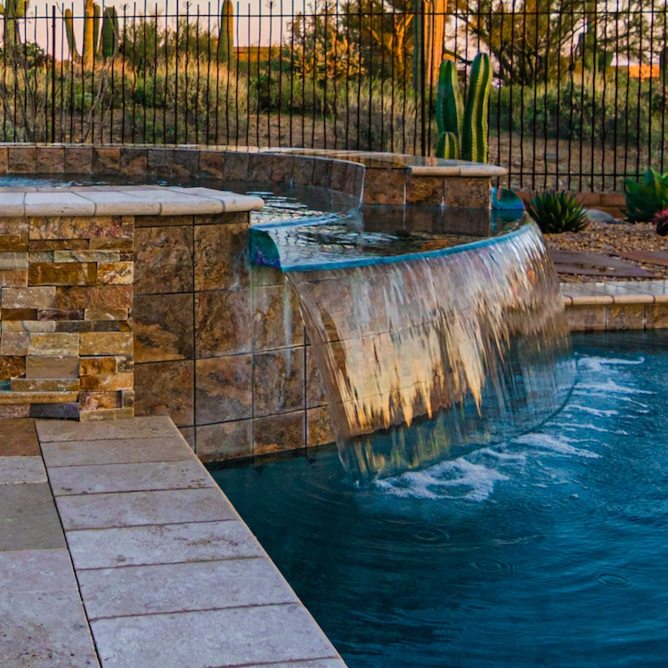 A beautiful spillover spa created by our Tucson pool and spa designers