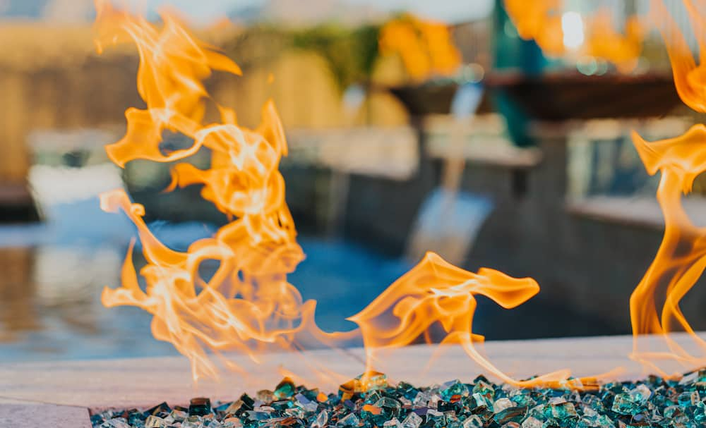 A close-up view of a poolside fire pit built by our luxury pool builders in Tucson, AZ