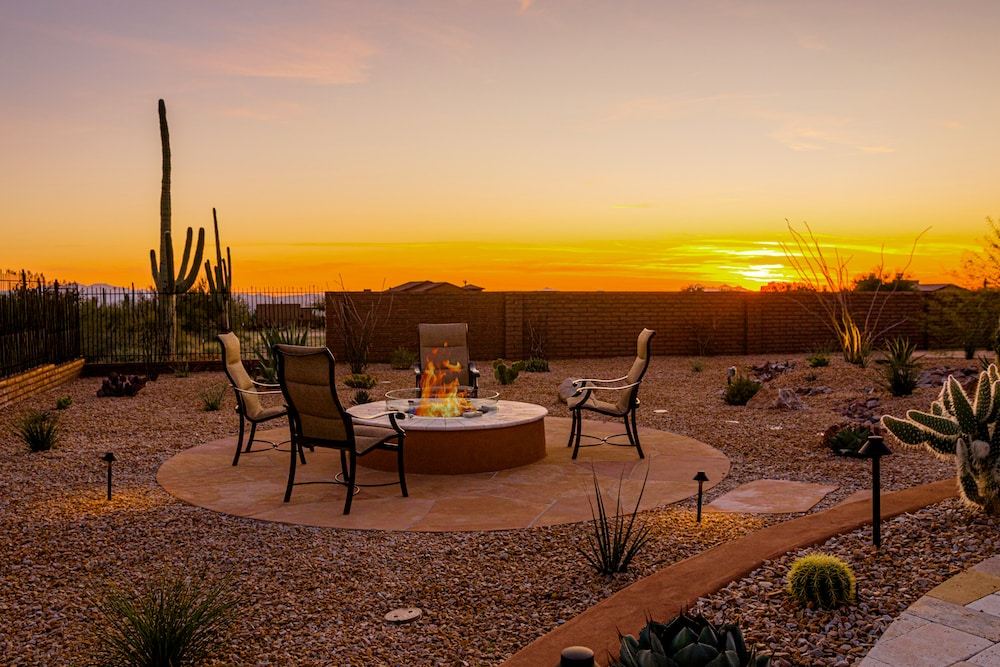 A fire pit built by our team in Tucson with a beautiful desert sunset in the background
