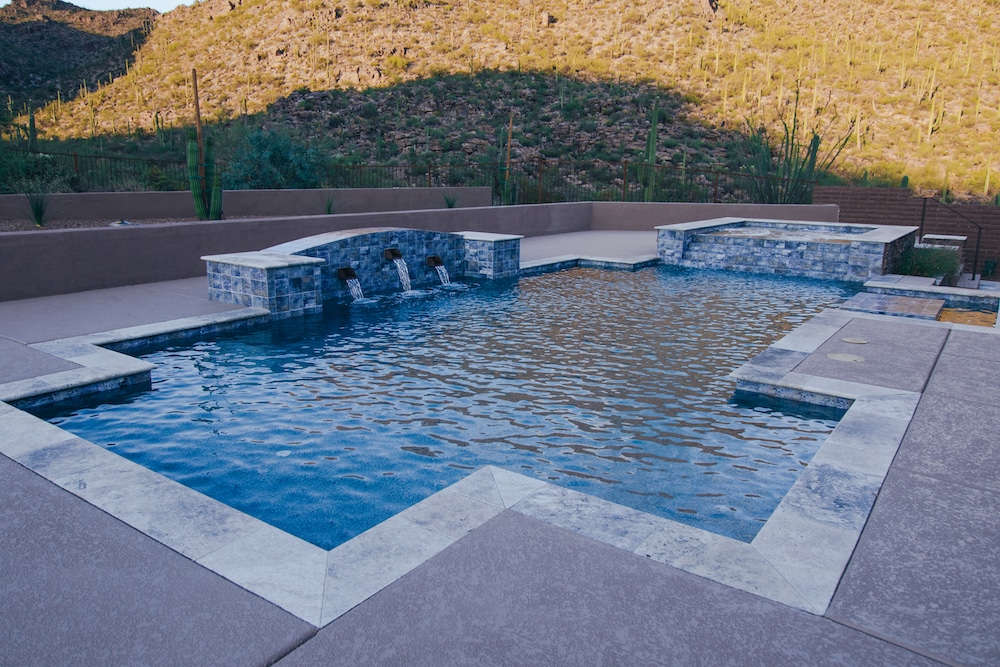 A contemporary pool with an angular, modern pool shape