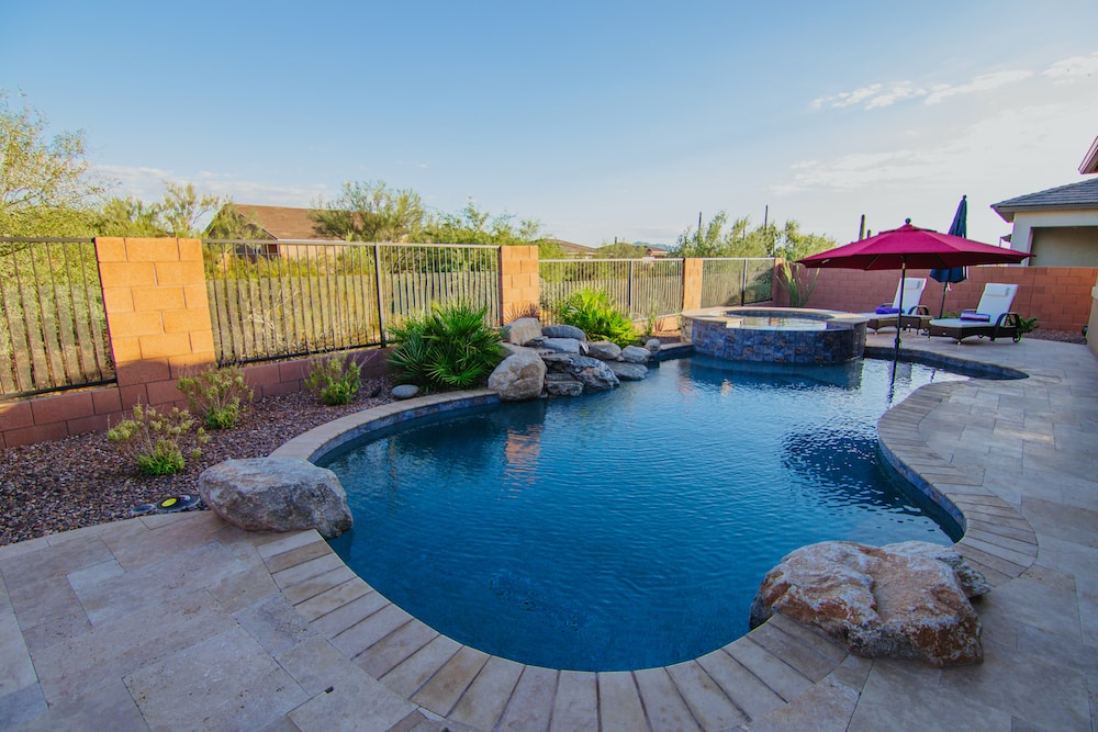 A freeform pool in Tucson built by our expert luxury pool builders and designers