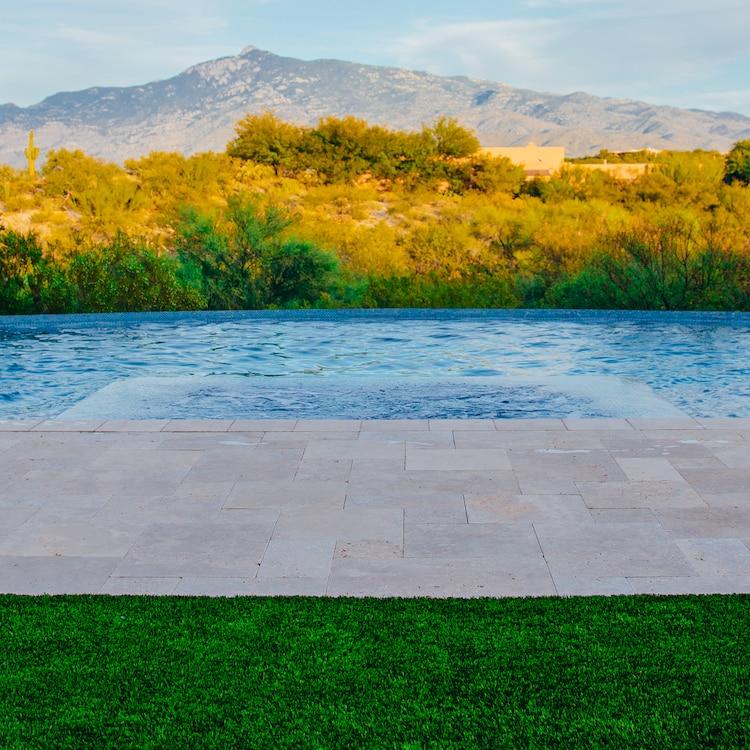 A minimalist pool design with a simple landscape