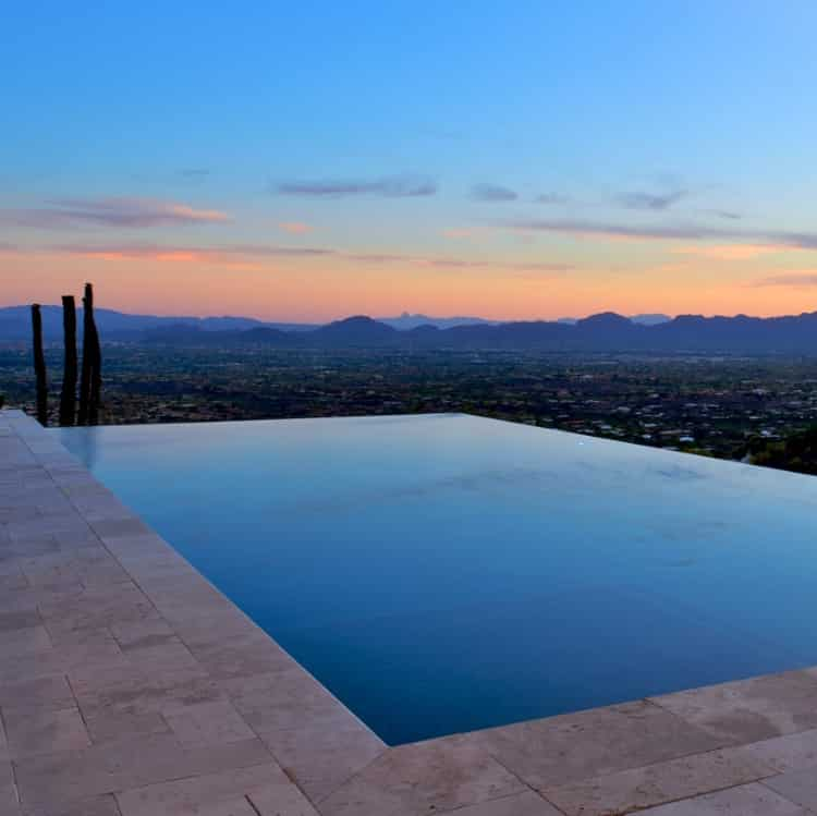 A pool with an infinity edge at sunset