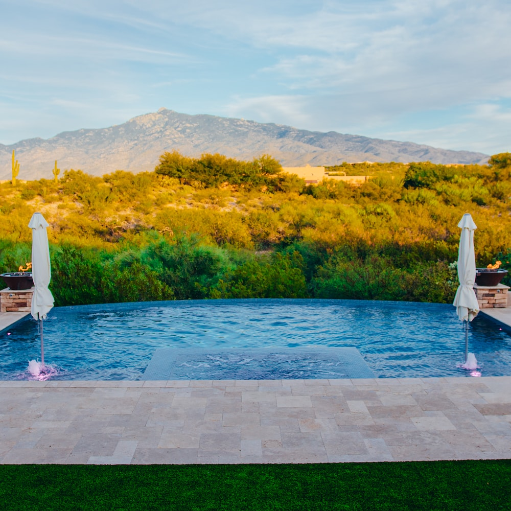 An infinity pool with a minimalist spa design on the same level