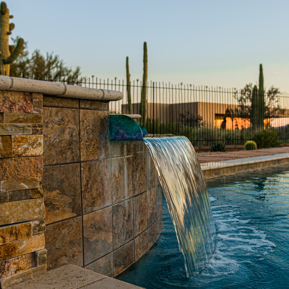 A close-up of water flowing out of a spillover spa in Tucson, AZ